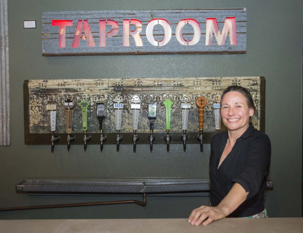 Brews - Co-owner, Katrina Pumphrey. They serve local beers on tap and as growlers.