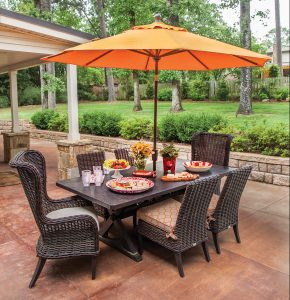 This outdoor dining set sits just outside the covered living area and extends the entertainment space, allowing guests to eat and/or play games ... while watching  Razorback football.