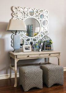 """Every teen room needs a desk or table for work space, whether it's used for homework, crafts or as a vanity. """"We used two ottomans, versus a chair; they are super easy to move around for use as extra seating,"""" Malcolm said."""