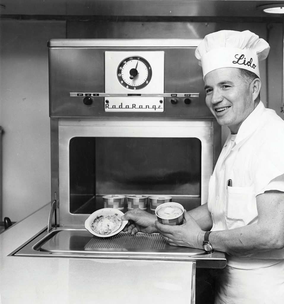 Wes Hall with a RadaRange microwave oven and Radar Deep Dish Pies.