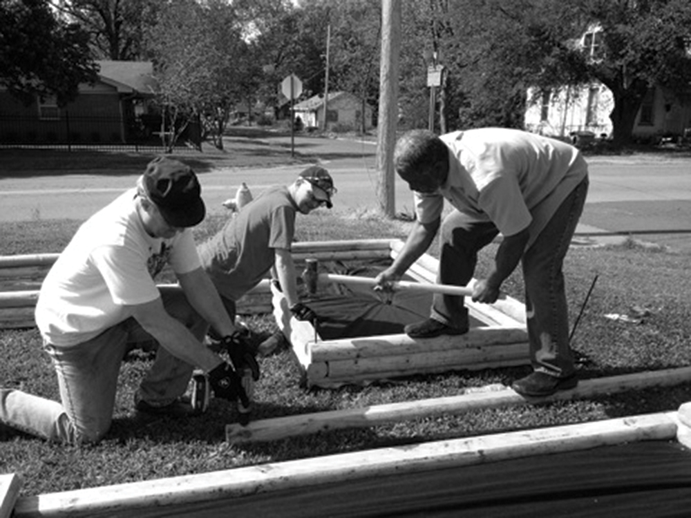 Volunteers at The Salvation Army building a garden.