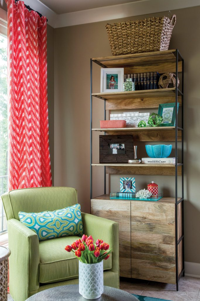 The storage items in this room are pretty and functional. The rounded table, as well as the bowl, planter and basket on the shelf, have depth, allowing items to be stowed away, completely out of sight. This industrial, modular 33-inch open & closed storage shelf is available through West Elm.