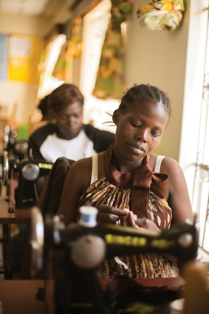 Women learning to sew at the James127 Foundation training center. // photo by maura dawn photography