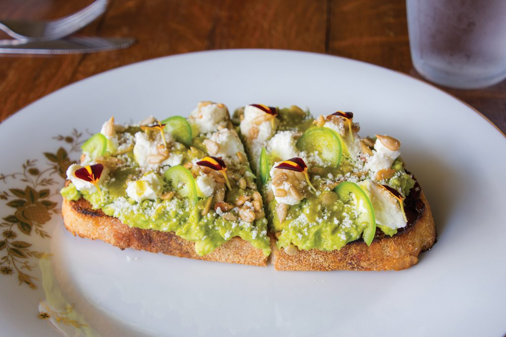Heirloom's avocado with ricotta cheese and sunflower seeds on a toasted baguette