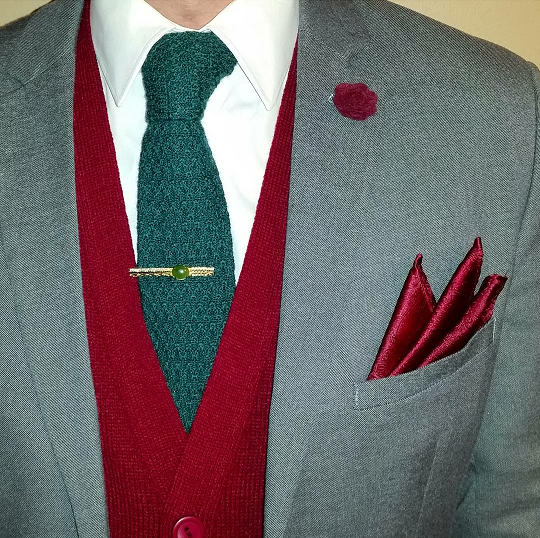 Ike Behar knit tie in evergreen paired with a cranberry cardigan is festive yet professional.