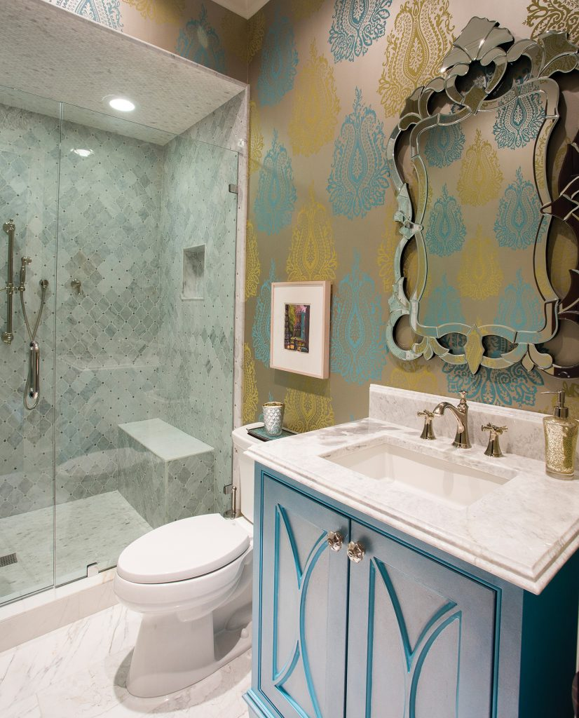 This full bath flows so well, because everything is tied together, from the wallpaper to the tile of the shower surround to the Contessa mirror. West then had Eric Phippen, owner of Penelope Design, faux finish the cabinet. The result is a bath that perfectly fits the easy elegance of the guest bedroom/study.