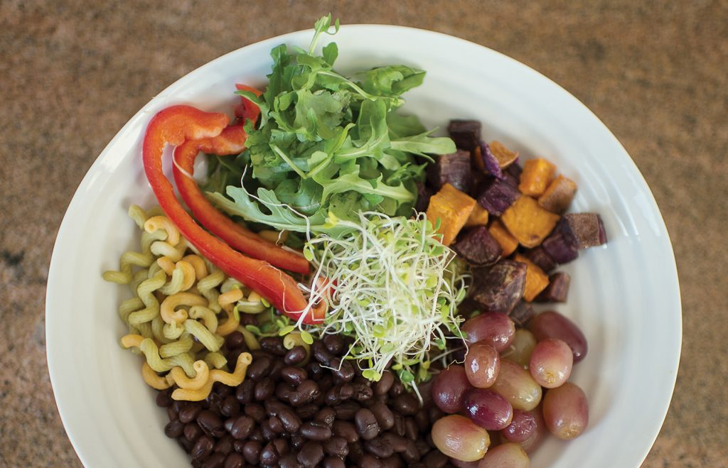 One of the duo's delicious grain bowls: roasted grapes, sweet potatoes, Japanese sweet potatoes, arugula, sprouts, red pepper slices, quinoa noodles and adzuki beans with a dressing of lemon juice, Dijon mustard, olive oil, shallots, salt, pepper and honey.