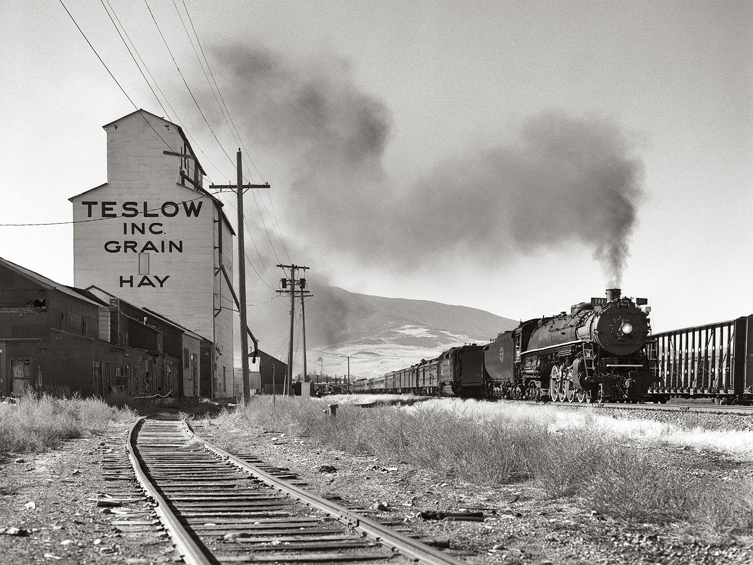 SP&S No. 700, a steam locomotive out of Portland, Oregon, leads a passenger train through Livingston, Montana and a bright autumn day in October 2002. This was the first time this route had seen a steam locomotive in 50 years.