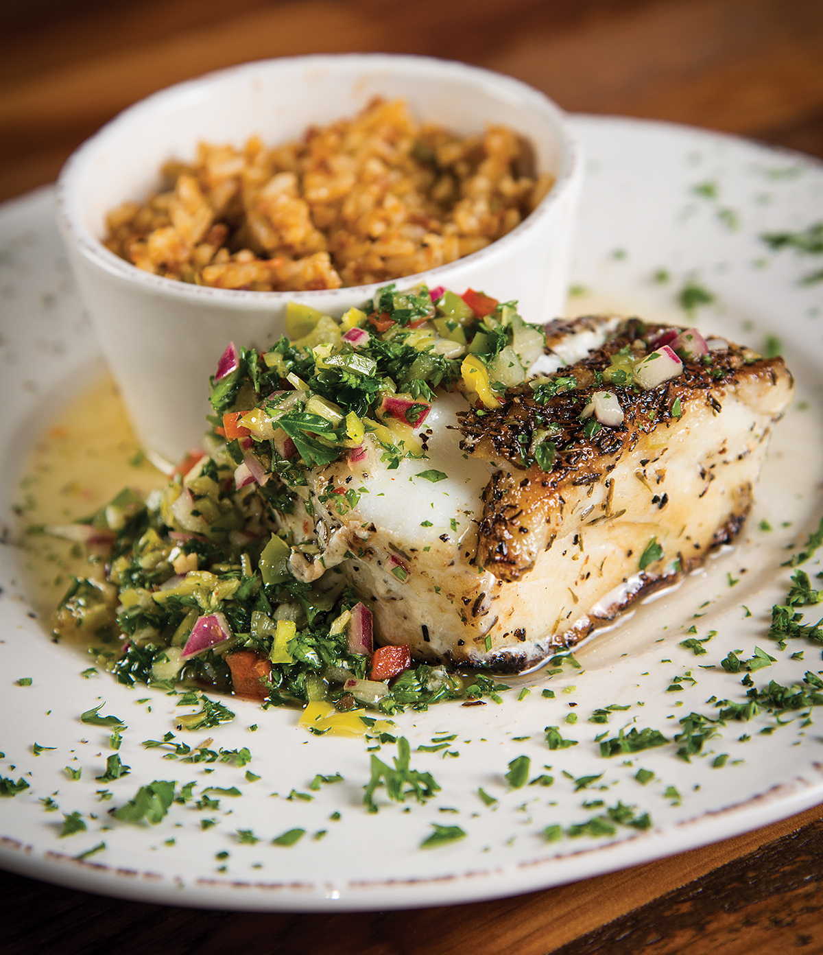Chilean sea bass with a side of New Orleans dirty rice