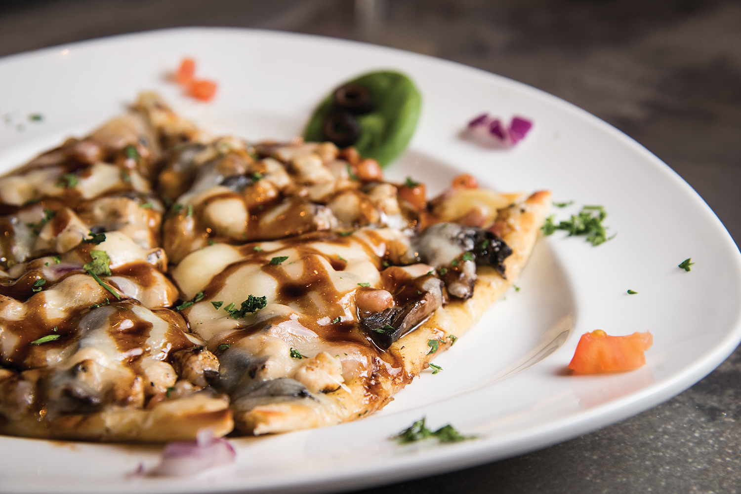 Italian flatbread  with grilled chicken, mushrooms, mozzarella cheese and fresh basil available on the gaming floor at Silks.