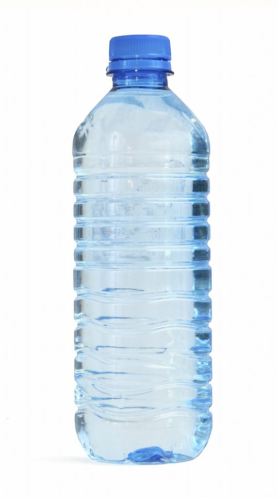 bottle full of water against white background, gentle shadow at the left side