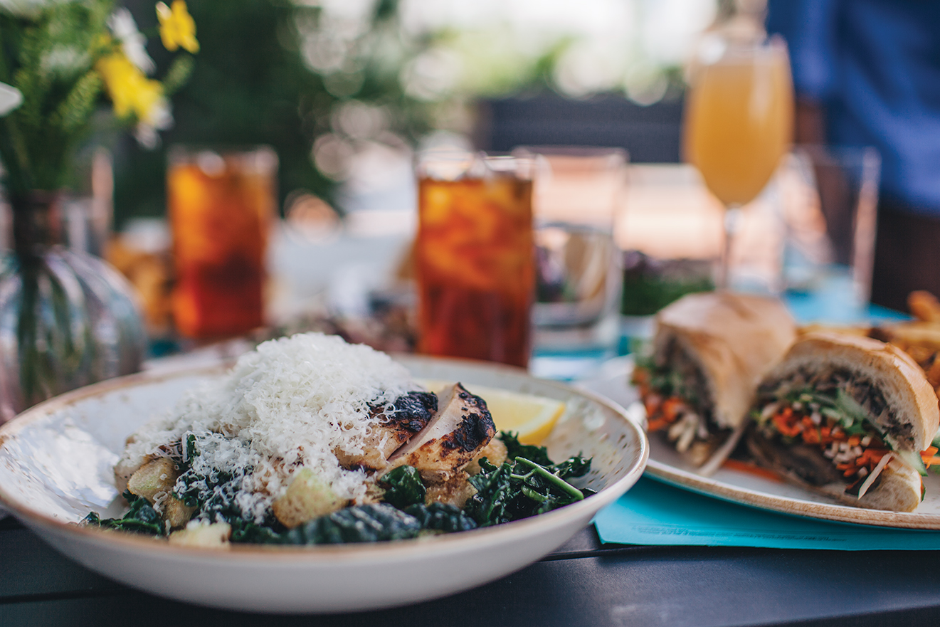 kale Caesar with grilled chicken breast: massaged kale, Parmesan, lemon, grated egg, Benton's bacon bits and Caesar dressing / Photo by BLK ELK Photography