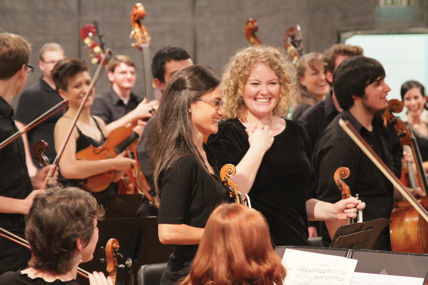 Violinists taking a bow after a performance.