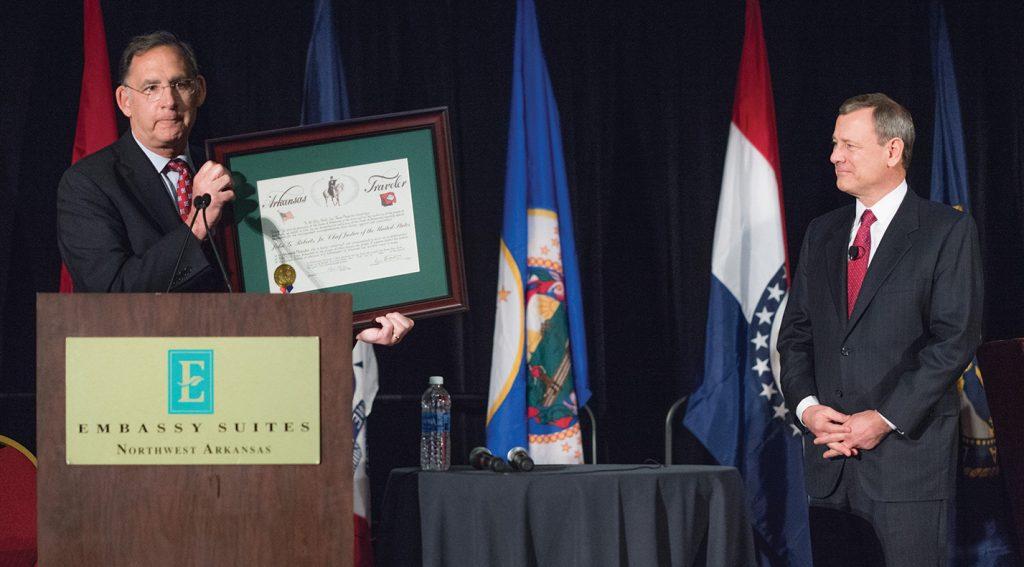 Chief Justice Roberts receiving his certificate from Sen. John Boozman; courtesy of John Boozman via Instagram.