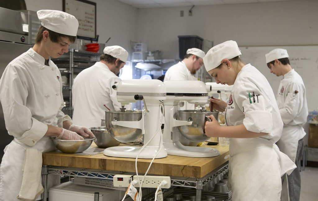 Students prepping to cater a college event; photo by Manda Jackson