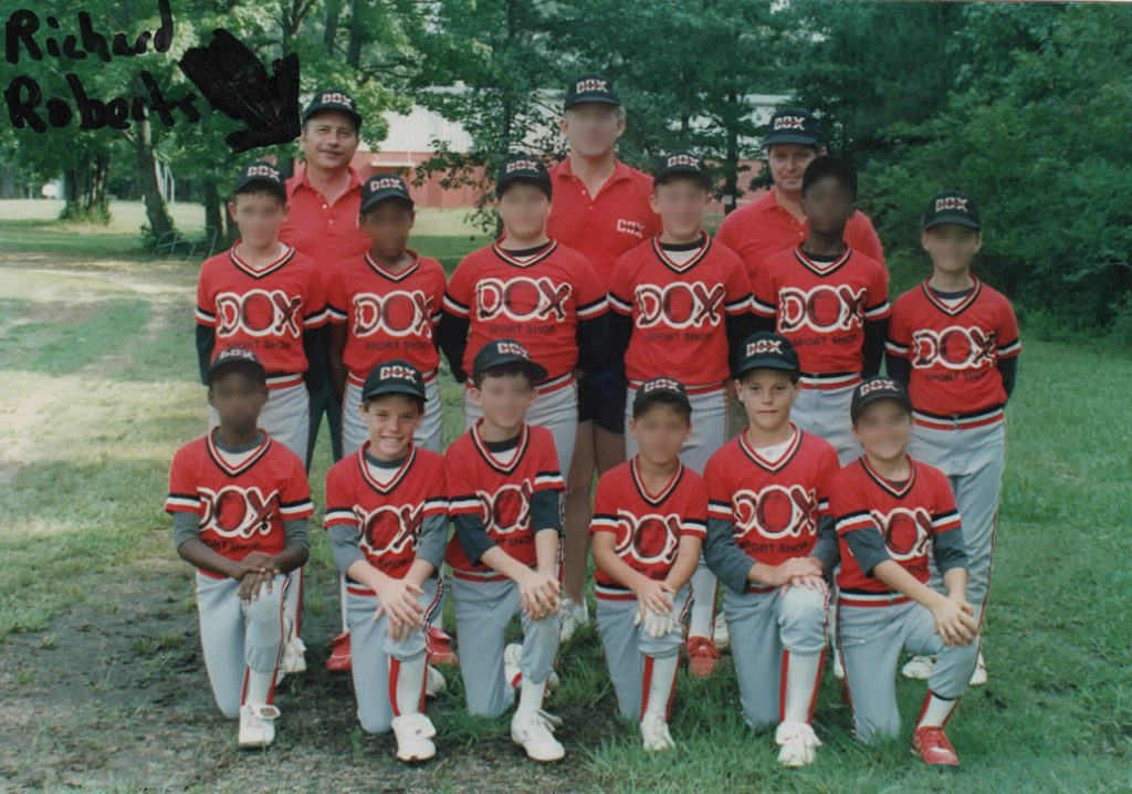 Smiles mask the deception and abuse by Coach Richard Roberts (arrow) of Matt, 8 years old, (first row, second from left) and Marc, 10 years old, (first row, second from right). Their father, Richard Smith (back row, right) helped coach the team. Smith was unaware of the abuse, until Marc informed him just before the arrest of Roberts in 2011.
