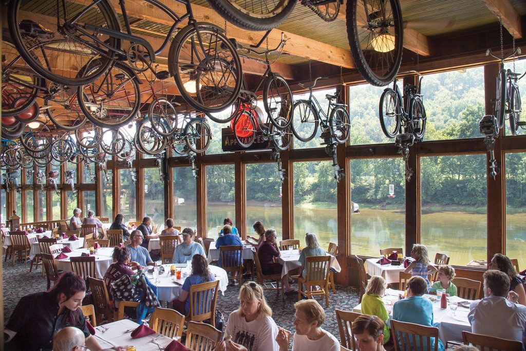 Guests enjoy the beauty of the Ozarks while dining.