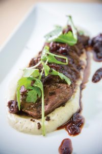 Cache's hanger steak; the menu also features a wagyu filet, a rib-eye and house filet.