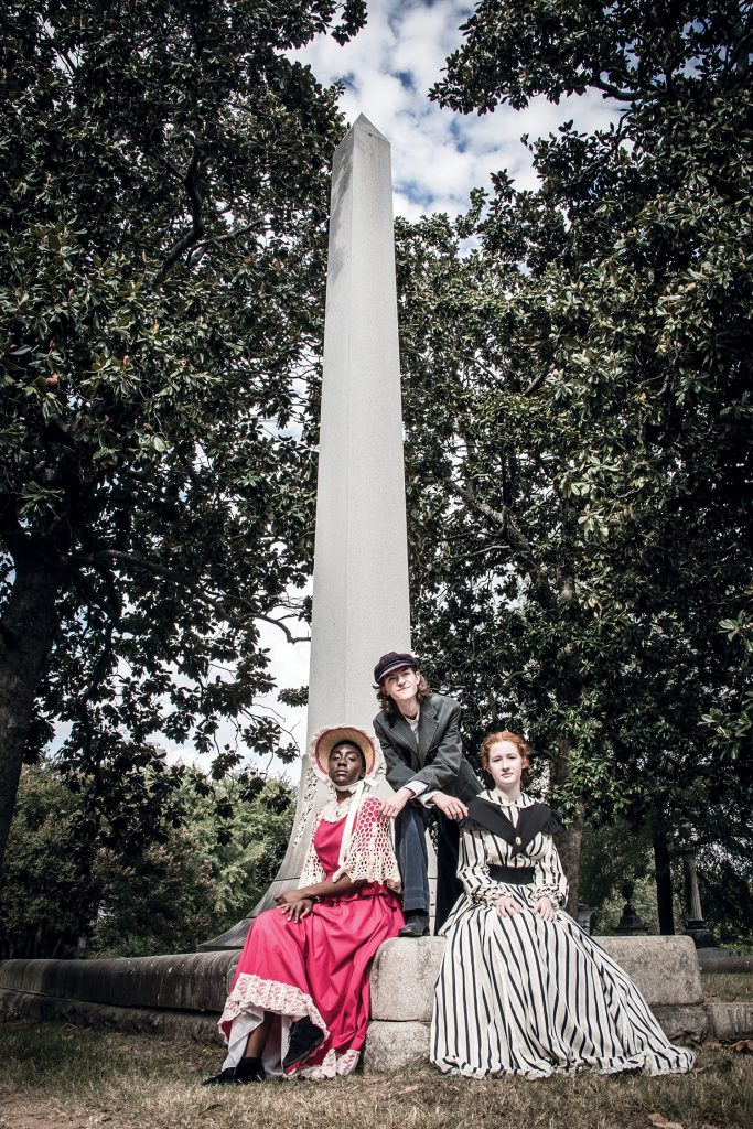 Parkview Arts Science Magnet High School drama students Angel Camper, Cameron Minor and Annaleise Anderson at the obelisk over the grave of Williams Booker Worthen, Mt. Holly Cemetery, Little Rock.