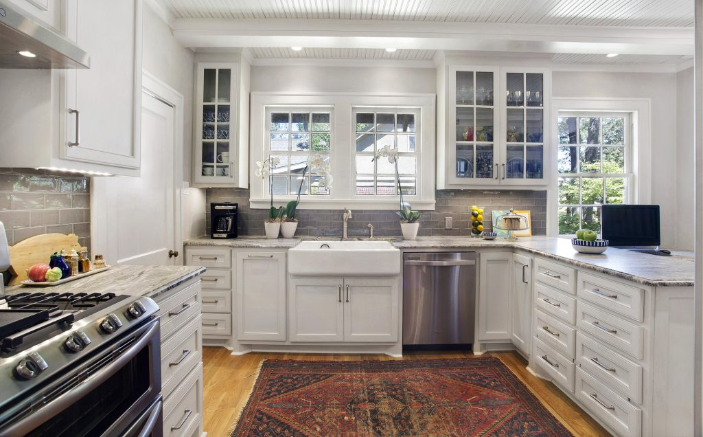 Cozy contemporary: What started as repainting the kitchen resulted in a beautiful renovation that pays homage to the 1930's cottage with a contemporary twist. Gary Mertins of mertinsdykehome suggestion to cover the ceiling with bead board was the perfect touch according to Allison.