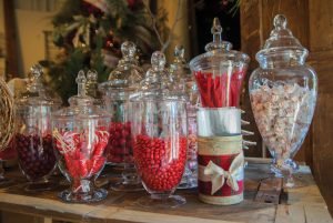 A candy bar, like this one at Tanarah Luxe Floral, adds color and sweet fun for your guests