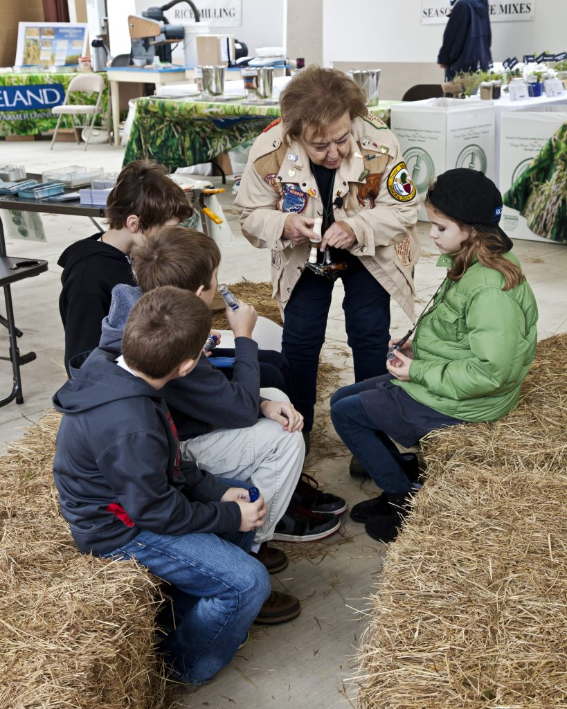 Pat Peacock, the only woman who has ever won the World Championship Duck Calling Competition, shows youngsters how to use duck calls.