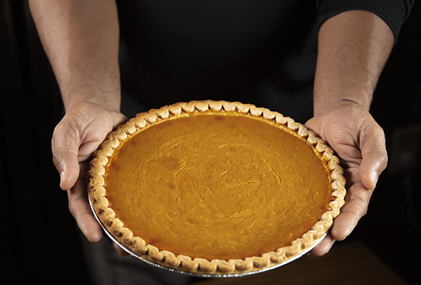 person holding a pie