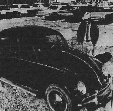 Car and man standing beside it